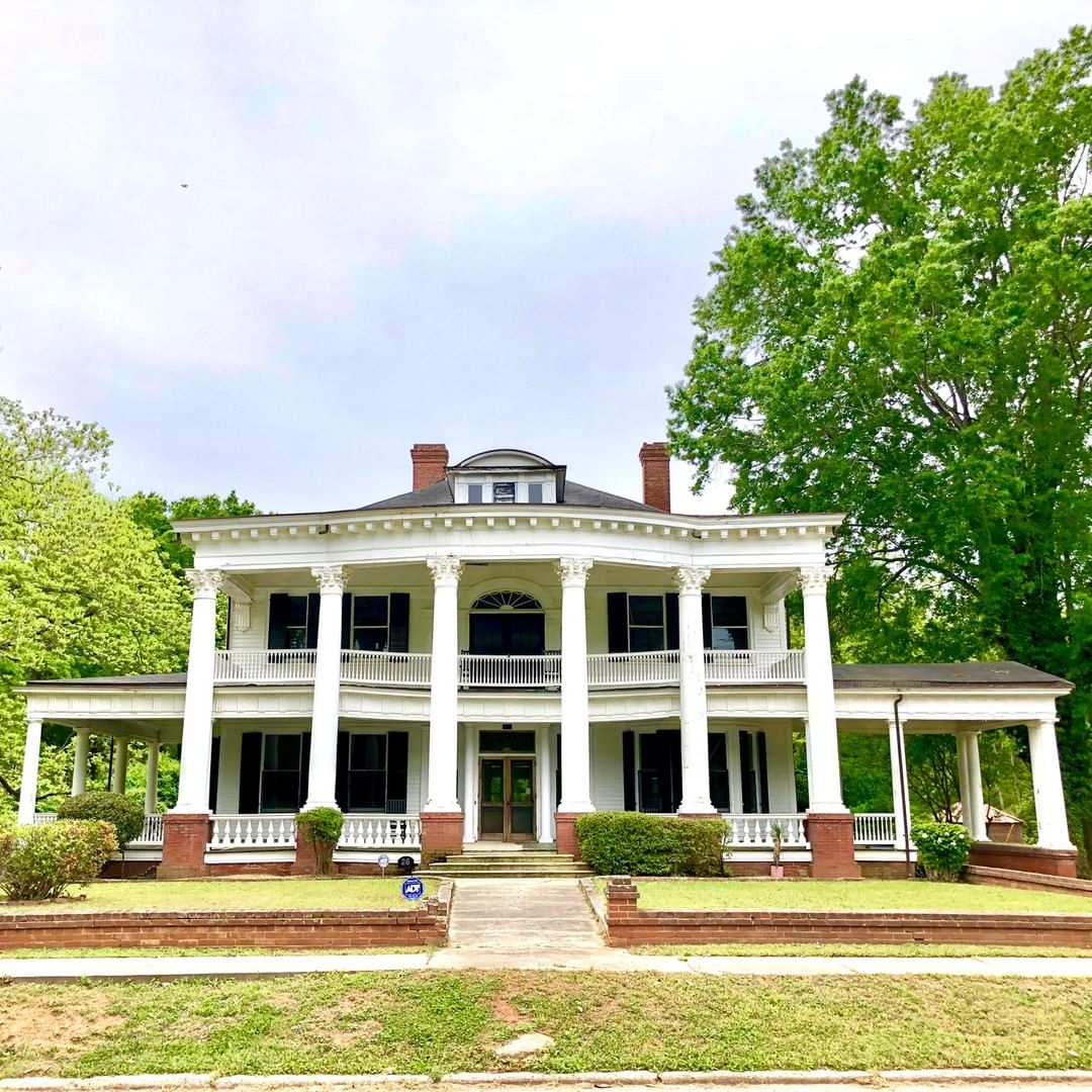 This Neoclassical home in Ridgeway was built around 1910 for Charles Wray, a railroad and bank executive. The home faces the railroad tracks. The entire Wray household died in a terrible train accident in 1919