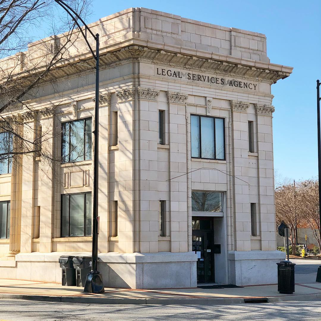 The American Bank Building is a 1920 Neo-Classical Revival style. The American Bank and Trust was chartered in 1890 and started in a former 1877 drug store at the corner of Augusta and Pendleton (now Main) St. This building was built in 1920 on the spot of the former building. It was the third bank established in Greenville