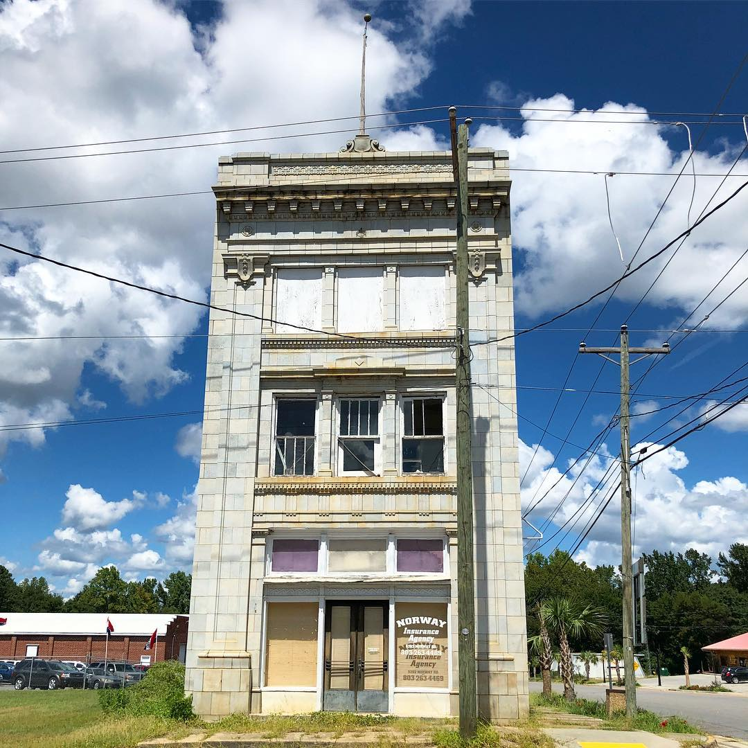 Built in 1919 by Norcom & Givens construction, this 3 story building was originally used as the Bank of Norway