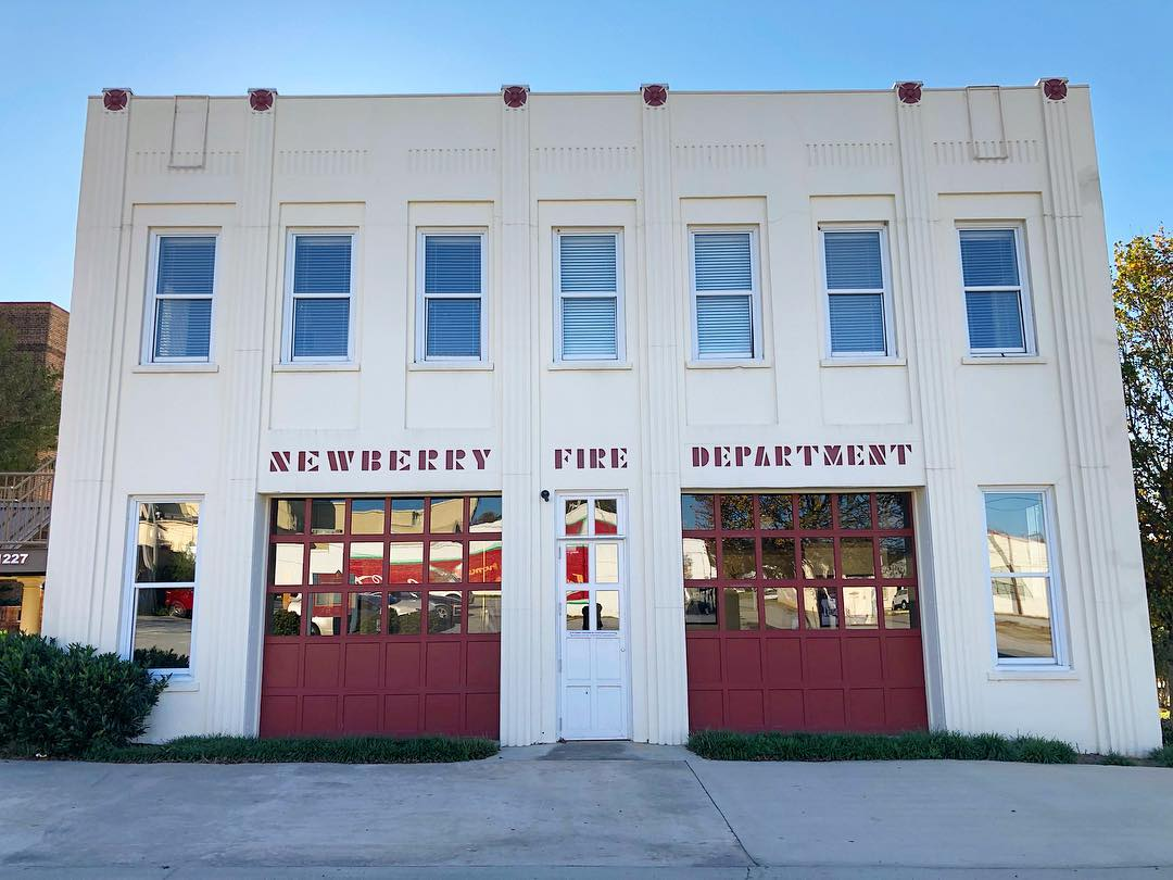 In 1883, the Newberry Fire Department was formed, housed originally in the Opera House.  Their own building was built next door and the Works Progress Administration remodeled the firehouse in the 1930's, expanding the building and giving it the Art Deco look. It was decommissioned in 1980, remodeled in 2005, and is now a conference center