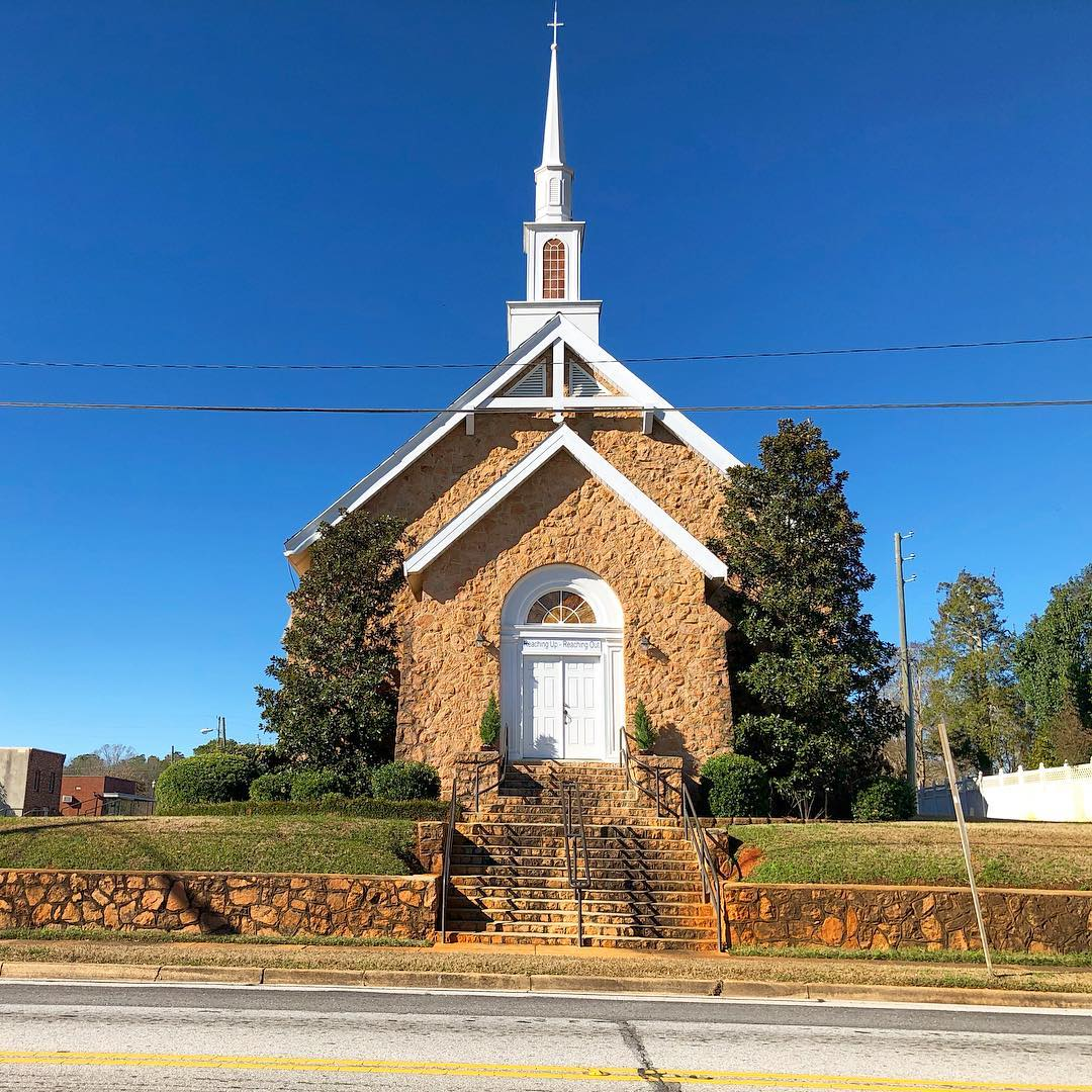 Originally built in Mt Tabor in 1883. In 1884 they decided to move the building to the current location. The church building was moved on logs to McCormick during 1884-6. In 1934 the church was turned to face Gold Street and then pink granite veneer was applied