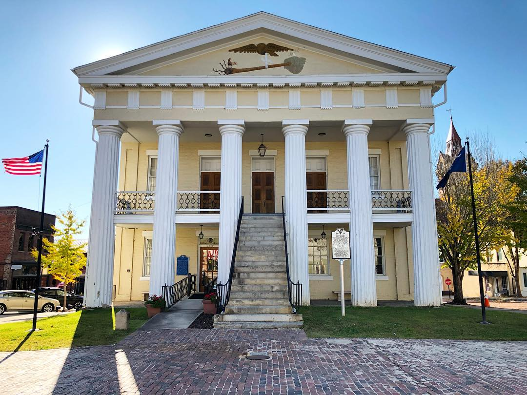 The Old Court House, erected 1852, was designed by Jacob Graves and built by James Damron in the Greek Revival style. This building, the fourth in a series of five County Courthouses, was used for court sessions between 1852 and 1906