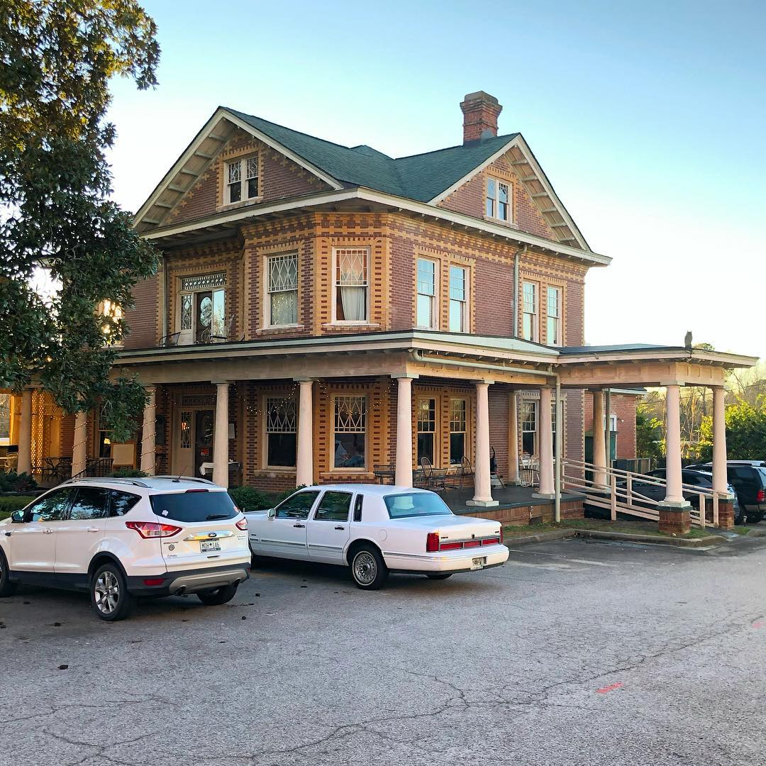 The Old Edgefield Grill is within the walls of a Victorian style home built in 1906. The restaurant has a cozy bar with antique church pews, three dining rooms with fireplaces with antique mantels