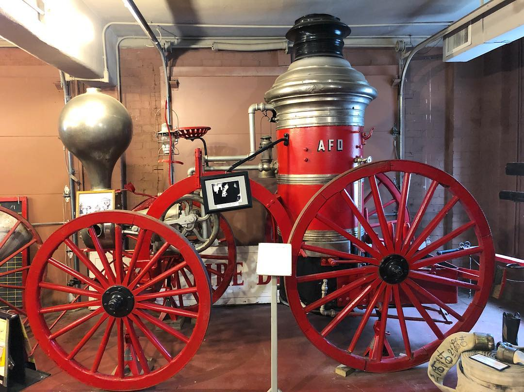 A carriage fire engine on display at the Aiken County Historical Museum