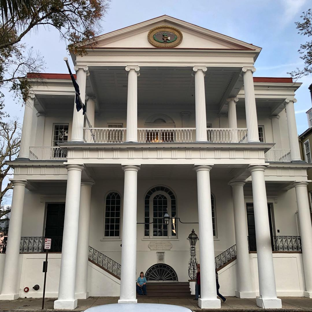 The South Carolina Society Hall was built in 1804. The first floor was used to school orphans and indigents, while the second floor was a ballroom for social purposes. In 1826 the first floor became a secondary school with both a Male Academy and Female Academy, both of which closed in 1841