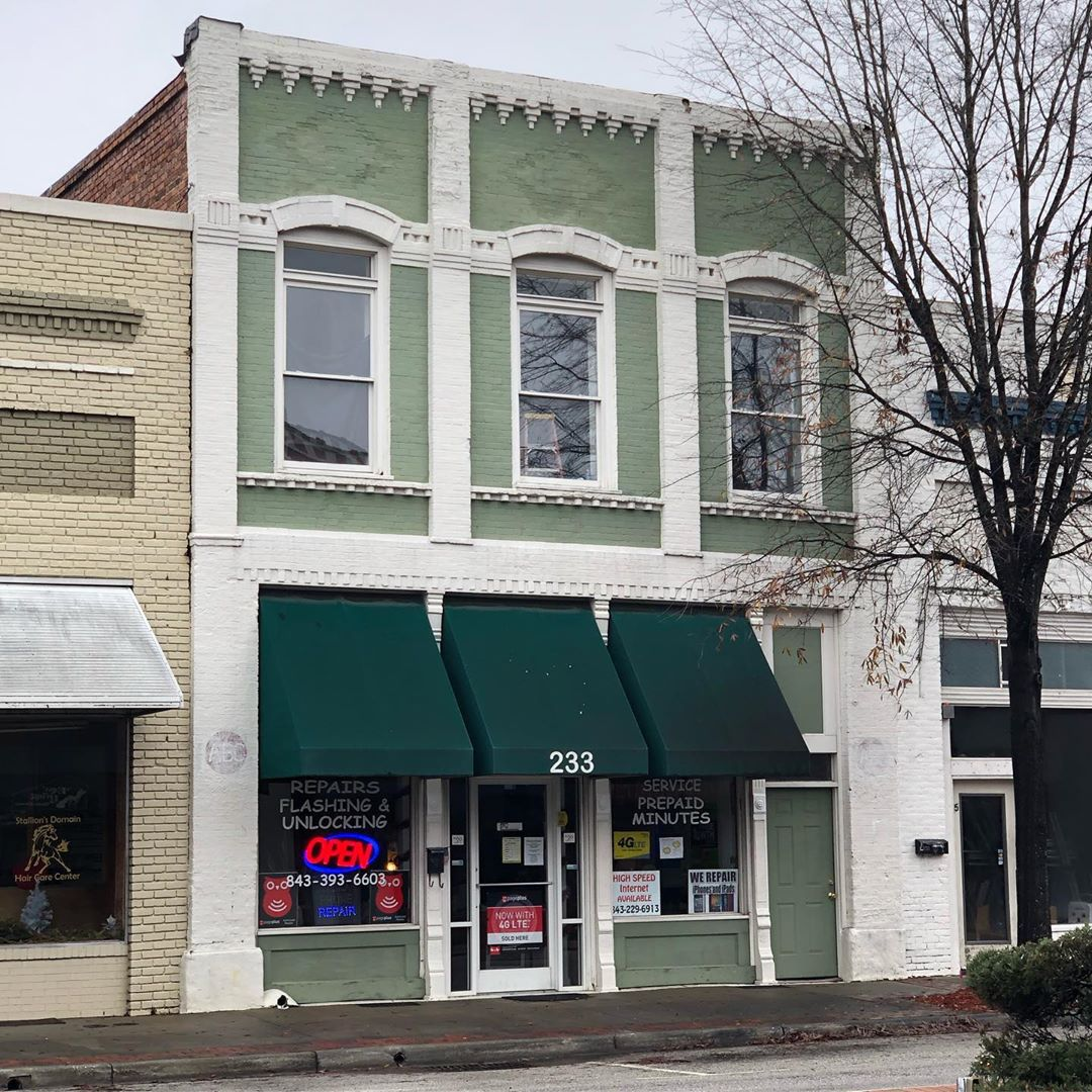 This brick commercial building was built in 1910. It is part of the Bishopville Commercial Historic District. Original diamond brickwork is still visible above the 2nd story windows