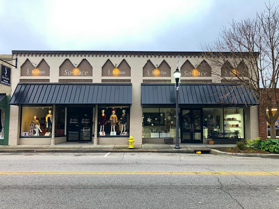 This building in Lake City was built in 1907. The glass and metal storefront on the left is original and the storefront on the right is a modern replacement