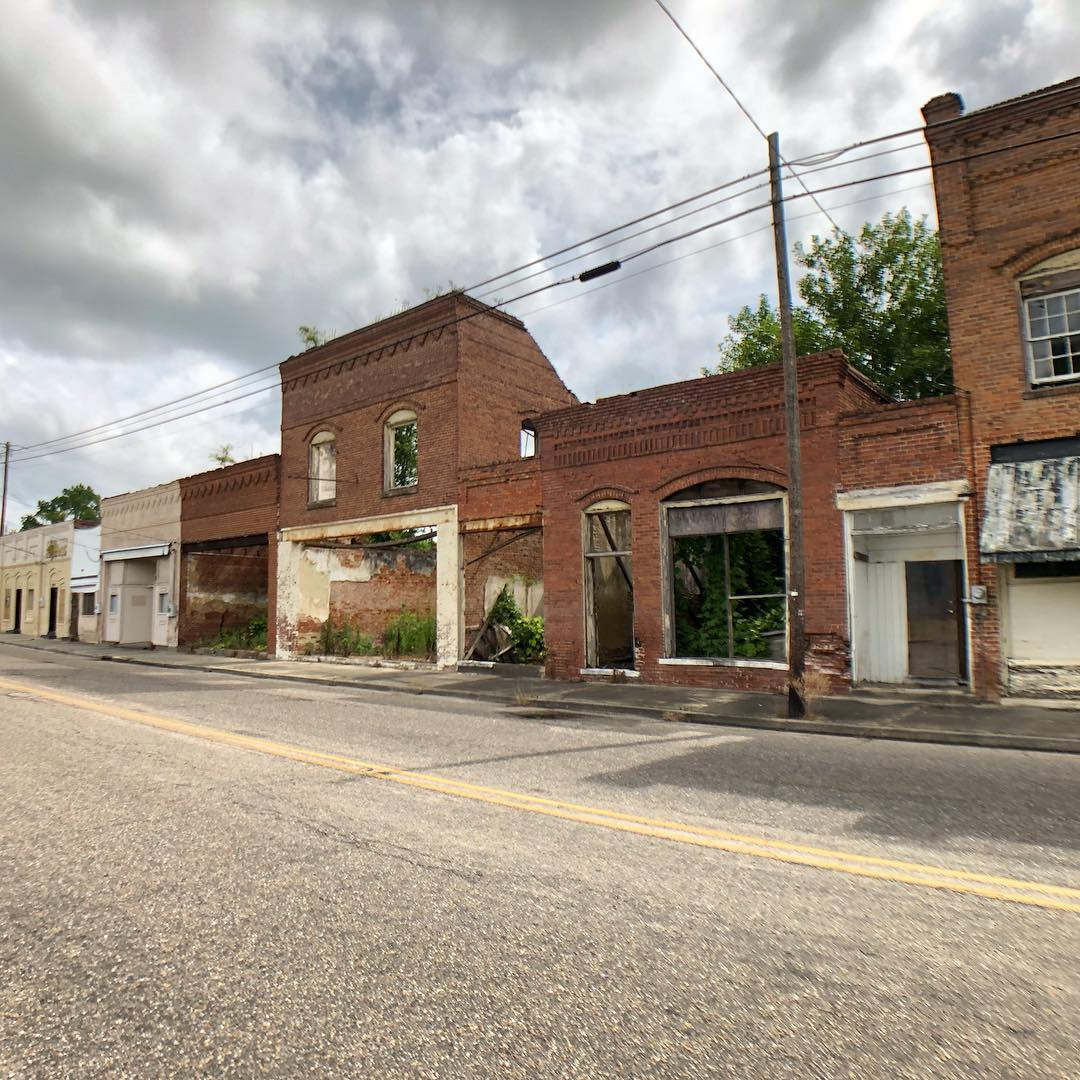 The town of Mayesville was named for the Mayes family after the Wilmington and Manchester Railroad cut through the Mayes' property and began as Mayes Station in 1852, replacing an earlier name of Bradleyville. Pictured are a row of stores built 1898-1920