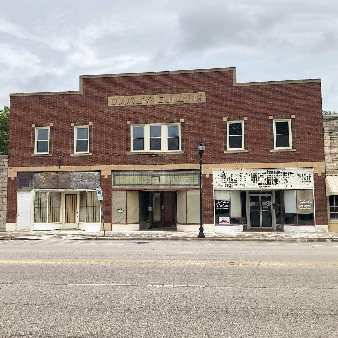 The Douglas Building, also known as Hinnant Hardware and Hudson's Grocery, was built about 1922