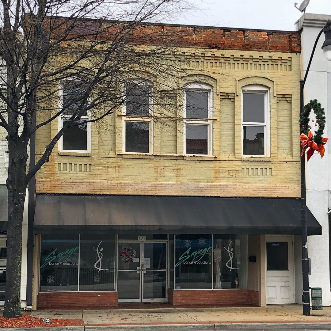 This brick commercial building was built in 1900. It is part of the Bishopville Commercial Historic District. It appears the original eaves were removed