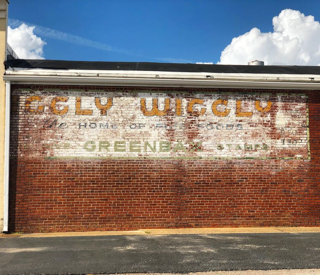 A faded Piggly Wiggly advertisement with Greenback stamps. This store was open from 1966 through 1995.  The New Ellenton Piggly Wiggly was owned by Mr. Edwin Breland Caldwell, Sr