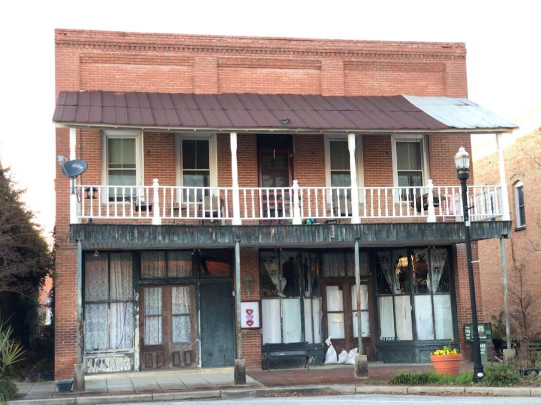 This 2 story commercial building with a 2nd floor balcony in Elloree was built in 1920.  Originally used as a boarding house on the second floor, one of the 1st floor business occupants was a grocer. If you find this building interesting, it is currently for sale