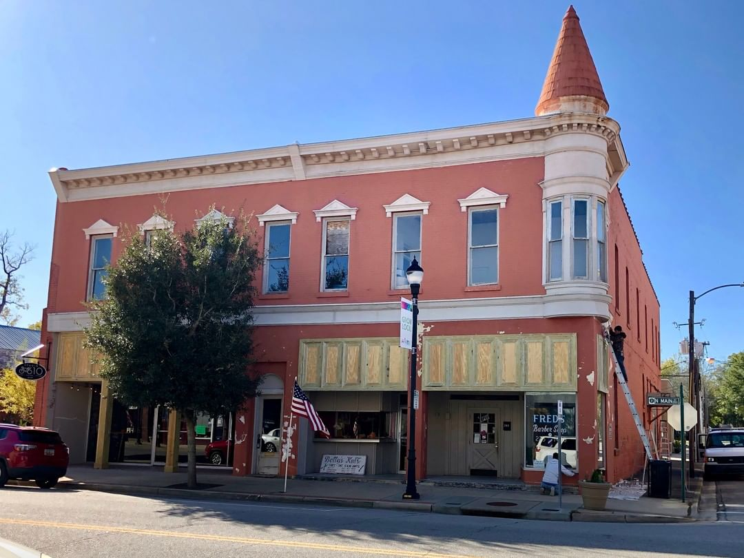 The Bobby Gerald Building in Marion was built in 1901. It is a two story brick structure with bracketed eaves, windows with pediments, and corner turret with conical roof