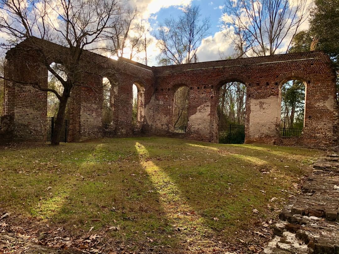 The Biggin Church Ruins was the church of the parish of St. John's, Berkeley (Strawberry Chapel). The church was established in 1706. This sanctuary was built in 1761 and reconstructed in 1781 after it was burned during the Revolutionary War. A forest fire around 1899 left the structure in the ruins pictured here