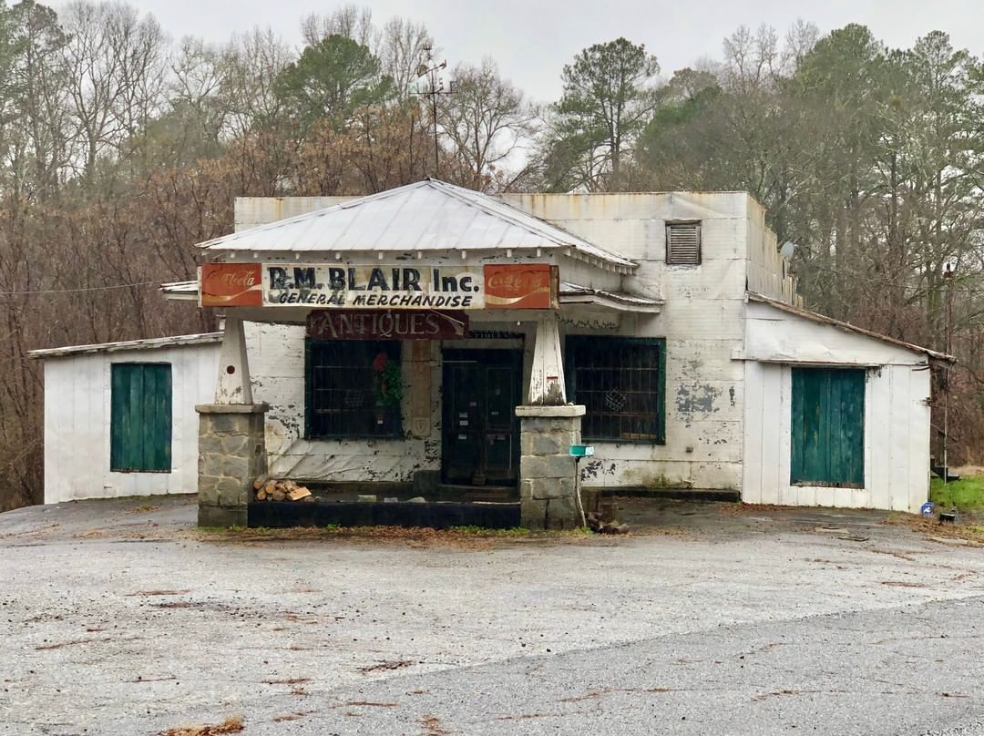 The R. M. Blair General Store and service station was built by Ray Blair in 1933. The building burned twice and was rebuilt both times. The Blair family settled there in 1798 and the town was named after them 