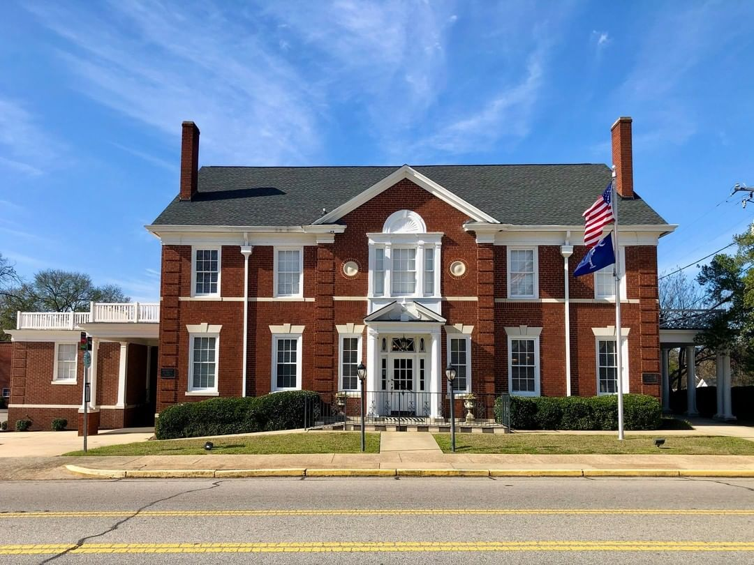 "The Thompson Funeral Home in West Columbia was built ca 1936. The Thompson Funeral Home dates back to 1928 when J.R. ""Buddy"" Thompson started this business. Around 1936, ""Buddy"" Thompson built this first building in this area that was built strictly for the use as a funeral home"