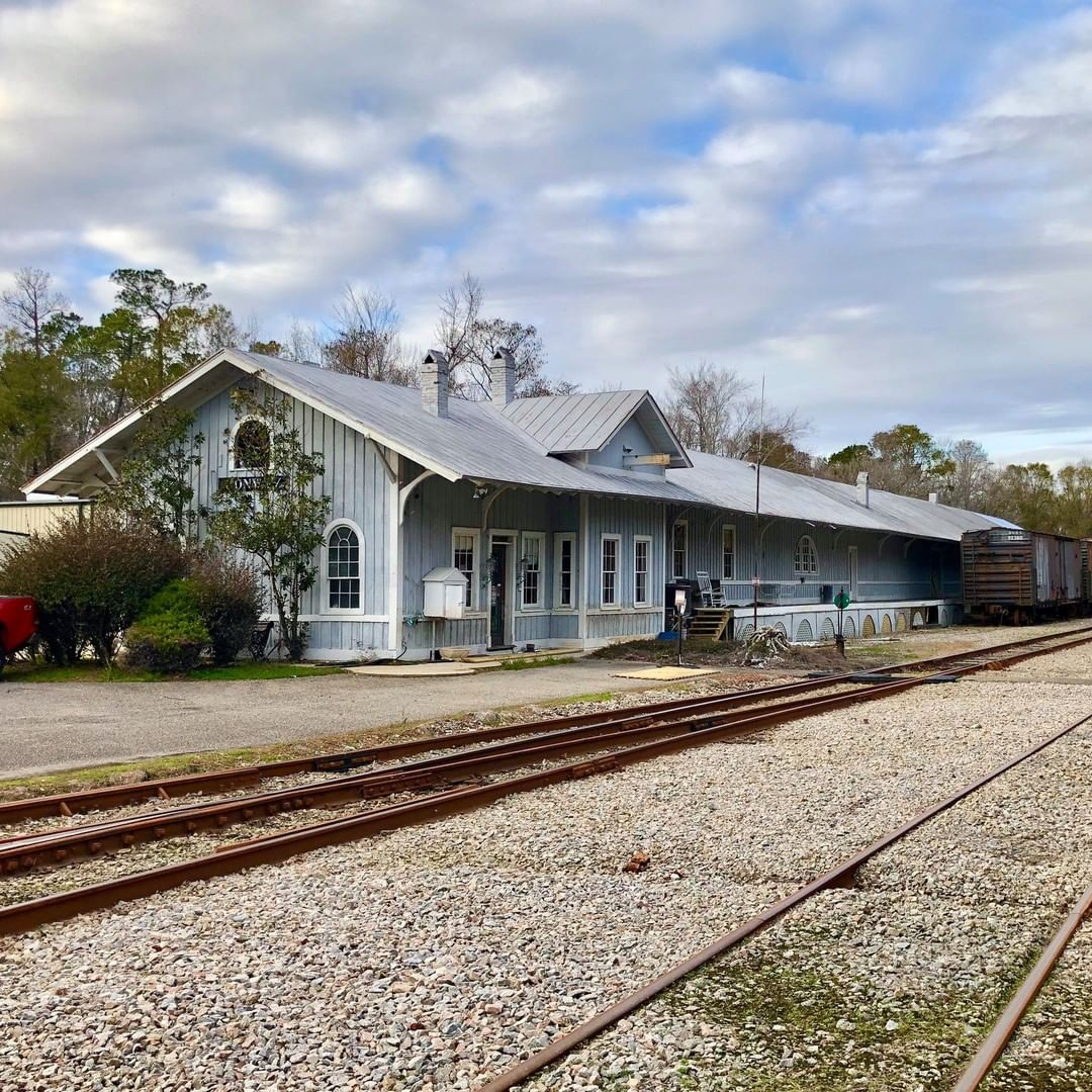 The Atlantic Coast Railroad Depot was constructed in 1928. The rail line started as the Wilmington, Chadborn, and Conway Railroad with a second rail line, the Conway Coast and Western Railroad, was built in 1896. The two interconnected in 1904 was purchased by the Atlantic Coast Line in 1912